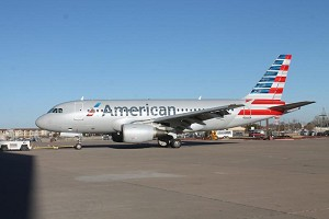 1st US Airways Aircraft Takes to the Skies in American Airlines Livery